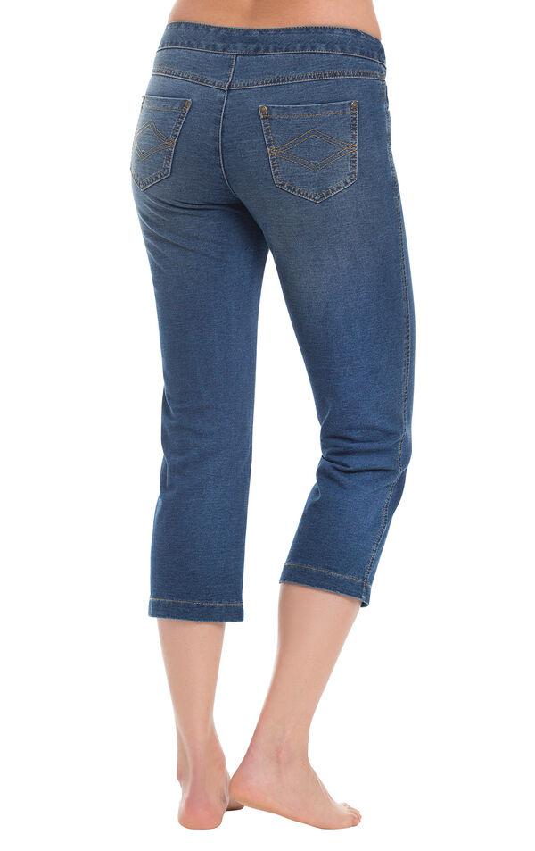 Model wearing PajamaJeans Capris - Bluestone Wash, facing away from the camera image number 1