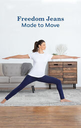 Model wearing Skinny Indigo Freedom Jeans in a yoga pose with the following copy: Freedom Jeans, Made to Move image number 2