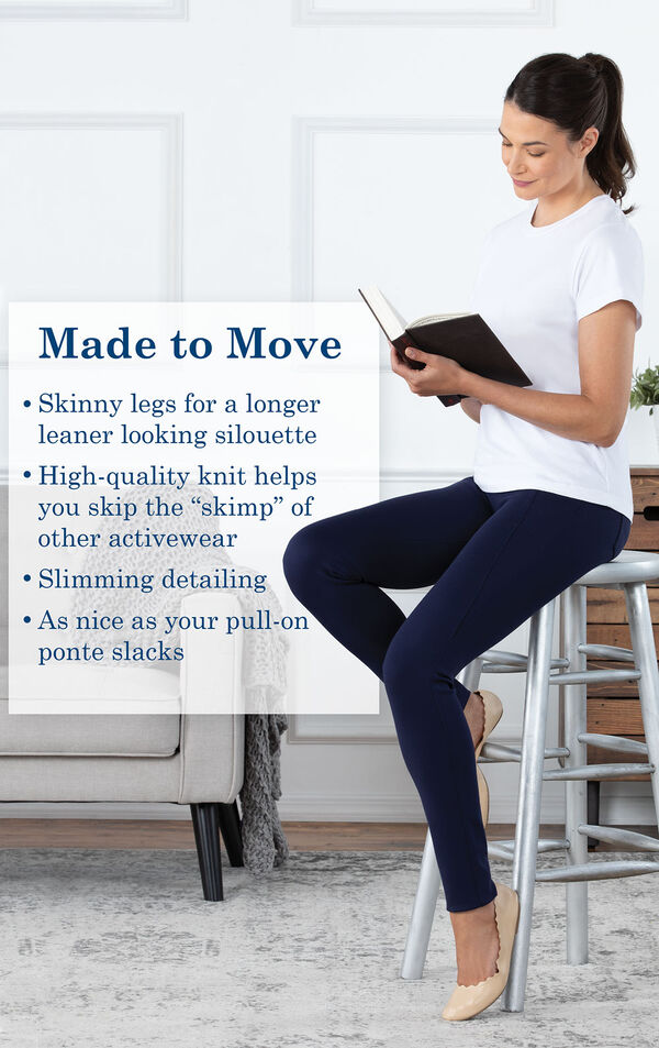 Model sitting on a stool wearing Skinny Indigo Freedom Jeans with the following copy: High-quality knit helps you skip the skimp of other activewear. Slimming detailing. As nice as your pull-on ponte slacks. image number 3