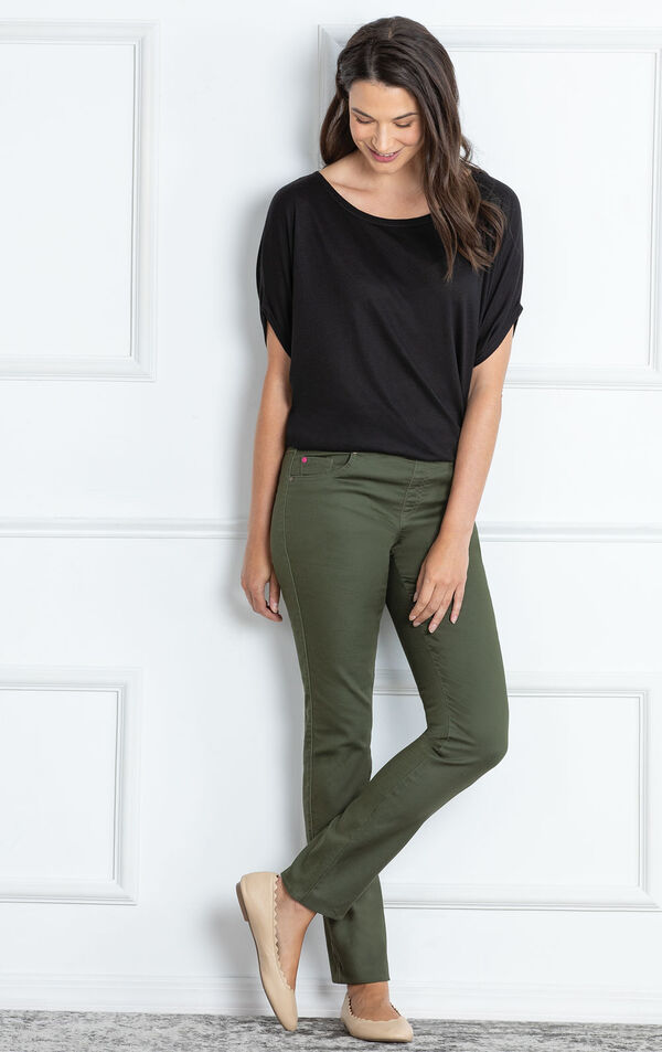 Model standing against wall wearing Skinny Olive PajamaJeans image number 2
