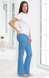 Model wearing Bootcut Cool Blue PajamaJeans paired with a white t-shirt and flats. image number 2