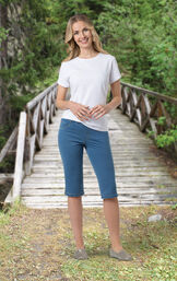 Model wearing Bermuda Wash Knickers paired with Gold flats and a White t-shirt, in the outdoors image number 2