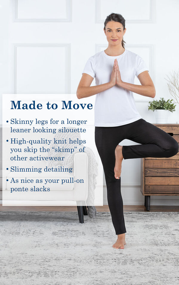 "Model doing a yoga pose wearing Skinny Black Freedom Jeans with the following copy: Skinny legs for a longer leaner looking silhouette. High-quality knit helps you skip the ""skimp"" of other activewear. As nice as your pull-on ponte slacks. image number 3"