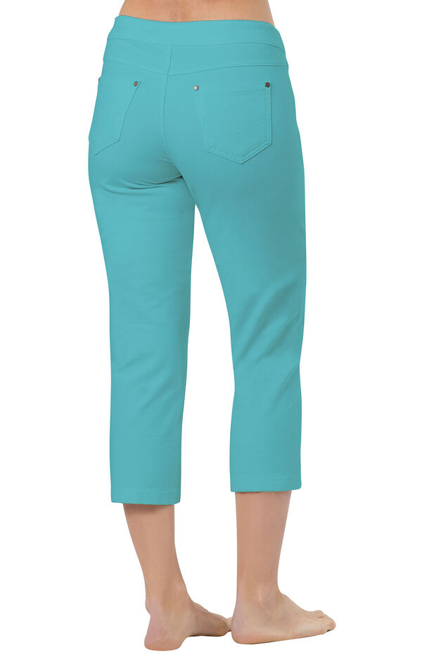 Model wearing PajamaJeans Capris - Aqua, facing away from the camera image number 1
