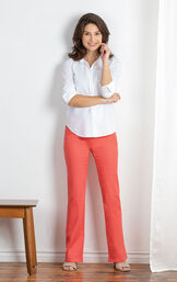 Model wearing Coral Bootcut PajamaJeans with a white blouse, standing image number 3