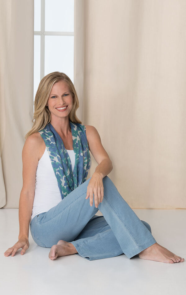 Model sitting wearing PajamaJeans - Bootcut Clearwater Wash paired with a white tank and scarf. image number 2