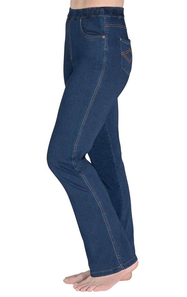 Model wearing PajamaJeans - High-Waist Bootcut Bluestone Wash facing away from the camera, displaying the side of the jeans image number 2