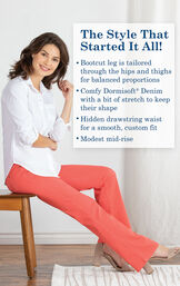 Model sitting on chair wearing Coral Bootcut PajamaJeans with the following copy: The Style That Started it All! Bootcut leg Is tailored through the hips and thighs for balanced proportions. Modest mid-rise. image number 4
