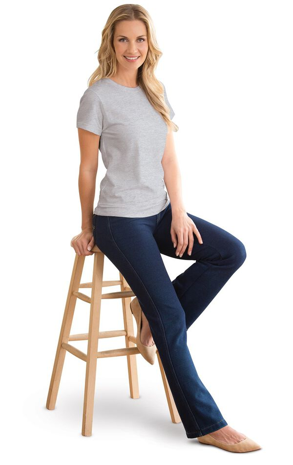 Model sitting on a stool wearing Bootcut Indigo PajamaJeans with a Gray T-shirt and Tan flats. image number 2