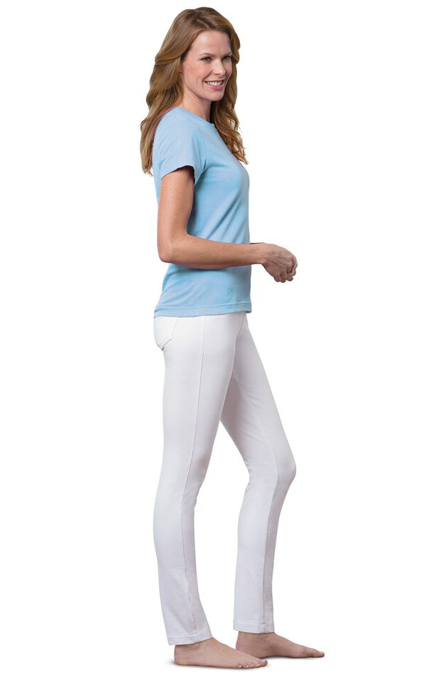 Model wearing Skinny White PajamaJeans barefoot, paired with a blue t-shirt image number 2