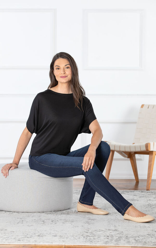 Model sitting on ottoman wearing Skinny Indigo Wash PajamaJeans paired with a Black top image number 2